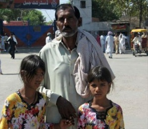 Ashiq Masih, husband of Asia Noreen, and their two daughters in a 2010 photo (CLAAS photo)