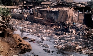 An unsanitary drainage area for toilets in the Kroo Bay shantytown on the coast of Freetown, Sierra Leone, contributes to the spread of disease