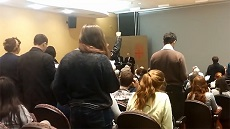 On October 29, 2013, a lecture at Brown University by New York City Police Department Commissioner Raymond Kelly (center, behind the podium at the front of the room) was abruptly cut-off and cancelled after unruly protesters repeatedly interrupted Kelly's speech and would not stop. (Image source: Brown Daily Herald YouTube screenshot)